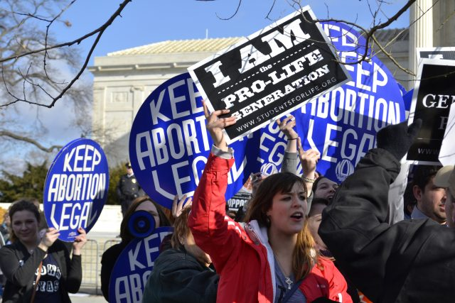 Washington D.C., USA - January 22, 2015; A Pro-Life woman clashes with a group of Pro-Choice demonstrators at the U.S. Supreme Court.
