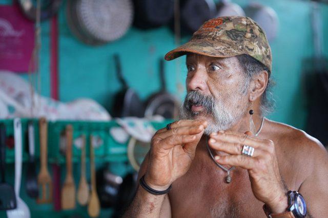 Molokai resident Thadd Camara sits in his living area that he built on property located on Molokai Hawaiian homestead land near the Molokai Airport.