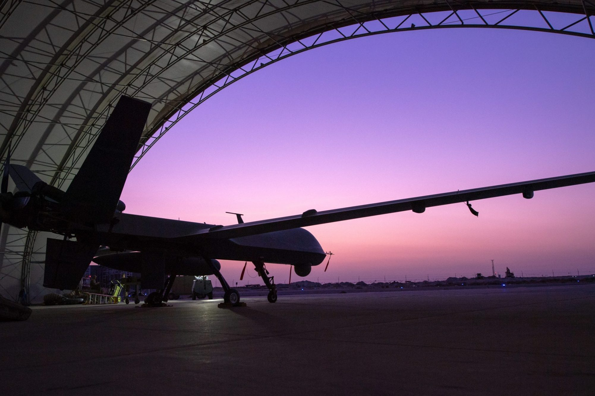 A U.S. Air Force MQ-9 Reaper remotely piloted aircraft awaits an engine test prior to Intelligence, Surveillance, and Reconnaissance operations at Ali Al Salem Air Base, Kuwait, July 23, 2019. Reaper's are maintained, launched and recovered from deployed locations, but are remotely operated from bases in the United States during ISR operations around the world. (U.S. Air Force Photo by Tech. Sgt. Michael Mason)