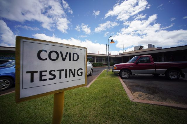 Molokai General Hospital Covid-19 testing sign located in the parking lot.