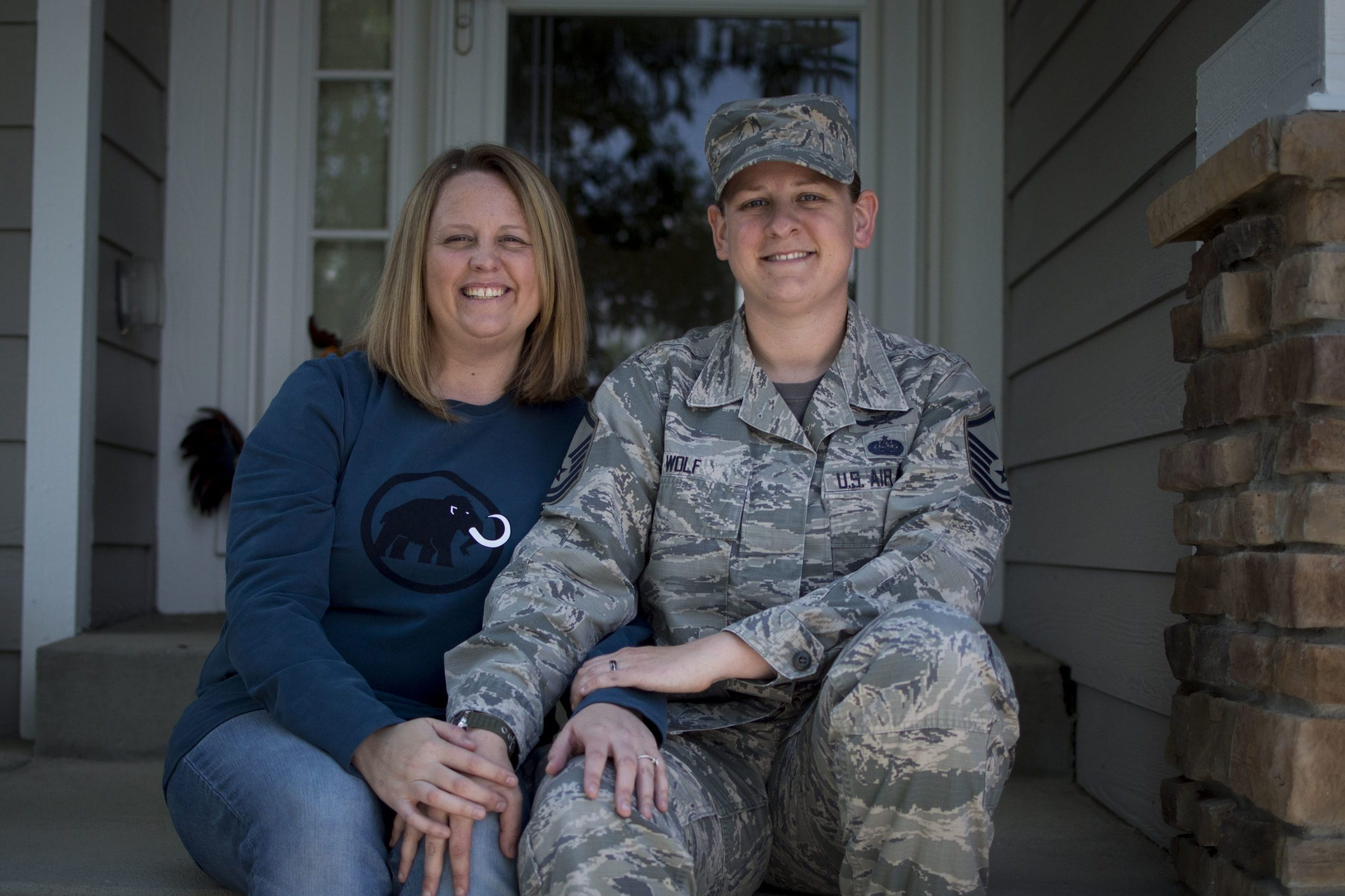 COLORADO SPRINGS, Colo. – Master Sgt. Sarah Wolf, 561st Network Operations Squadron noncommissioned officer in charge, sits at home in Colorado Springs, Colorado, June 15, 2018, with her wife, Amy Wolf, who she met while they both were stationed at Hickam Air Force Base, Hawaii, in 2013. After the 2011 repeal of Don't Ask Don't Tell, a military policy that didn't allow gays or lesbians to be vocal about their sexual orientation, it was sometimes hard for Sarah to talk about her significant other. Sarah said the Air Force has been supportive of her, and in 2016, Sarah and Amy got married in Hawaii. (U.S. Air Force photo by Audrey Jensen)