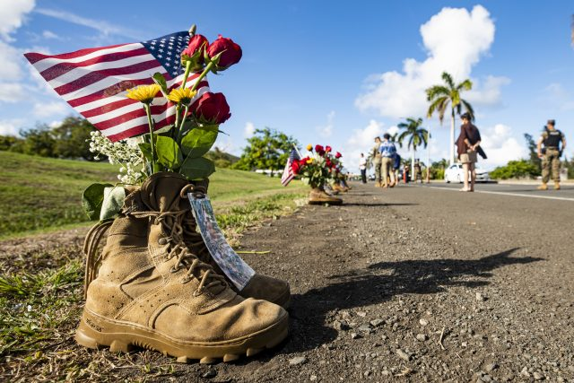 A pair of boots is displayed as part of a memorial aboard Marine Corps Base Hawaii, Aug. 29, 2021, in remembrance of the 13 service members recently killed in Afghanistan. The memorial, comprised of community donations, was displayed at the entrance of MCBH. (U.S. Marine Corps photo by Lance Cpl. Samantha Sanchez)