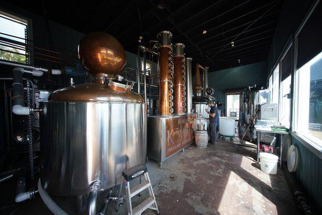 Hawaiian Agricultural Rum Distillery Kohana Director Tyler Johnson checks a batch of rum as it distills through the